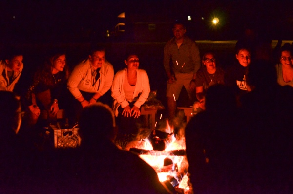 Image of 2016 FIT First attendees around a campfire
