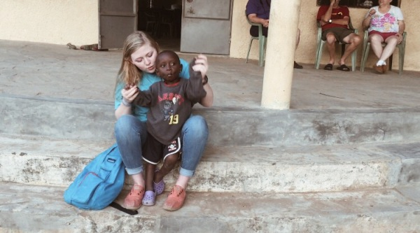 Image: Anna singing and dancing with one of the children at Ray of Hope Orphanage in Kenya. Photo courtesy of Anna Stewart Faircloth.