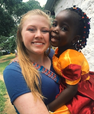 Image: Ray of Hope Orphanage in Kenya: Anna and one of the children after a church service. They became fast best friends!